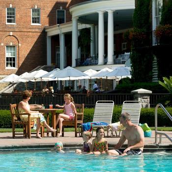 Outdoor pool and patio at Guestroom at The Otesaga Resort Hotel.