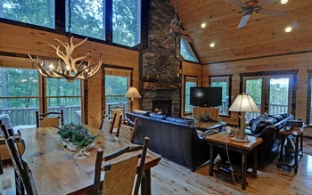 Cabin dining and living room at Mountain Top Cabin Rentals.
