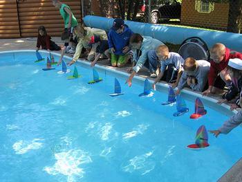 Sailboat making and races at Half Moon Trail Resort.
