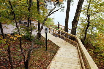 Stairway to patio viewing the lake at East Silent Lake Vacation Homes.
