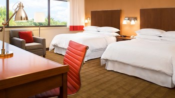 Guest room at Four Points by Sheraton Saginaw.