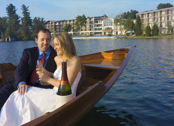 Couple on lake at Golden Arrow Lakeside Resort.