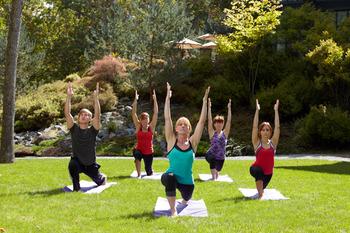 Outdoor yoga at The Lodge at Woodloch.