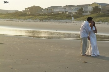 Wedding Couple On Beach at The Sunset Inn