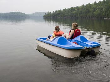 Paddle boat on lake at Fiddler Lake Resort.