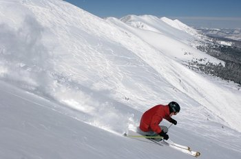 Downhill skiing at Breckenridge Discount Lodge.