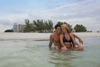 Couple in ocean at Guy Harvey Outpost.
