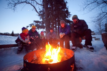 Family by the fire at Temperance Landing on Lake Superior.